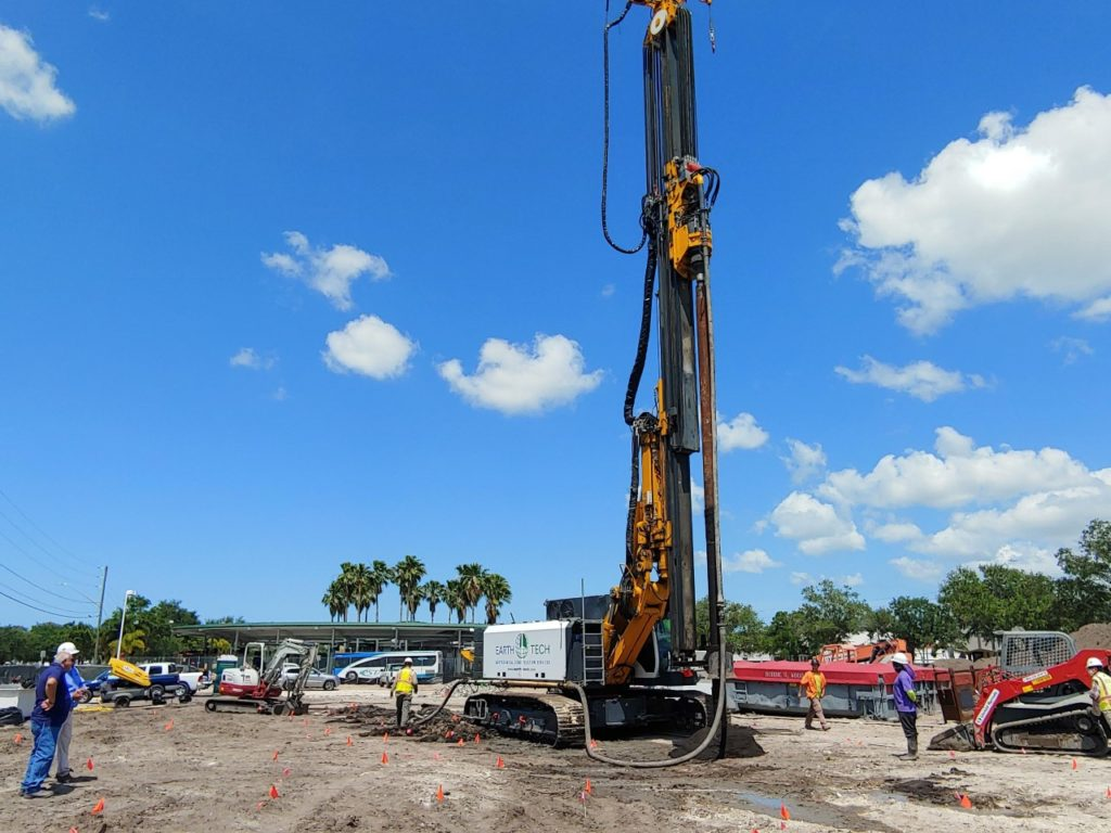 Construction site showing workers and heavy machinery.